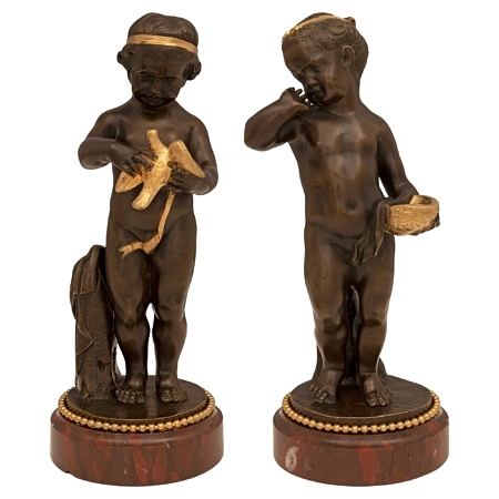 A pair of French 19th century Louis XVI st. patinated bronzes, ormolu and Rouge Griotte marble statues